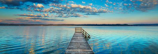 Boat ramp and filigree clouds, Bavaria, Germany