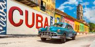 Vintage car and mural, Cuba